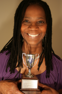 Adult student with the Silver Senior Cup for 3 years of consecutive Superior Grades.